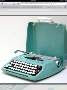 This is a Smith-Corona portable manual typewriter. I remember using one of these when I was growing up. Clack, clack, clack. Ding.